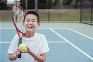 boy with tennis
